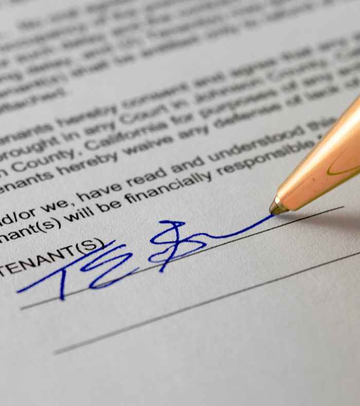 pen showing the signing of a tenant contract